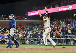April 30, 2018 - San Francisco, CA, U.S. - SAN FRANCISCO, CA - APRIL 30: San Francisco Giants Catcher Buster Posey (28) celebrates with his walk off run during the ninth inning of San Francisco Giants and San Diego Padres game on April 30, 2018 at AT&T Park in San Francisco, CA. (Photo by Stephen Hopson/Icon Sportswire) (Credit Image: © Stephen Hopson/Icon SMI via ZUMA Press)