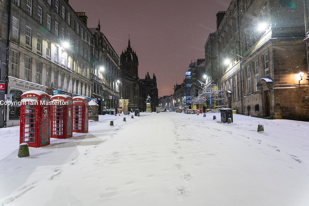 Edinburgh, Scotland, UK. 10 Feb 2021. Big freeze continues in the UK with heavy overnight and morning snow in the city. Pic; An empty Royal Mile in early morning snow.  Iain Masterton/Alamy Live news