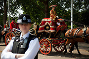 WPC on duty. Royal procession for the State Opening of Parliament, London. Accompanied by the Life Guards and the Blues and Royals, this procession takes Queen Elizabeth to parliament to deliver the Queen's Speech. Accompanied in the procession by her State Crown and a golden Mace.
