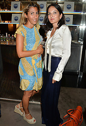 The UK Premier of Johnnie Walker Blue Label's 'Gentleman's Wager' - a short film starring Jude Law was held at The Bulgari Hotel & Residences, 171 Knightsbridge, London on 22nd July 2014.<br /> Picture Shows:-Left to right, SAMIRA PARKINSON-SMITH and YASMIN MILLS.