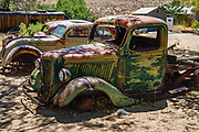 Rusting truck in Benton Hot Springs, Mono County, California, USA. Benton Hot Springs (elevation 5630 feet) saw its heyday from 1862 to 1889 as a supply center for nearby mines. At the end of the 1800s, the town declined and the name Benton was transferred to nearby Benton Station.