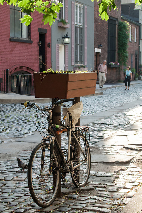 A bicycle parked in Washington Mews, a private, gated street near Washington Square.