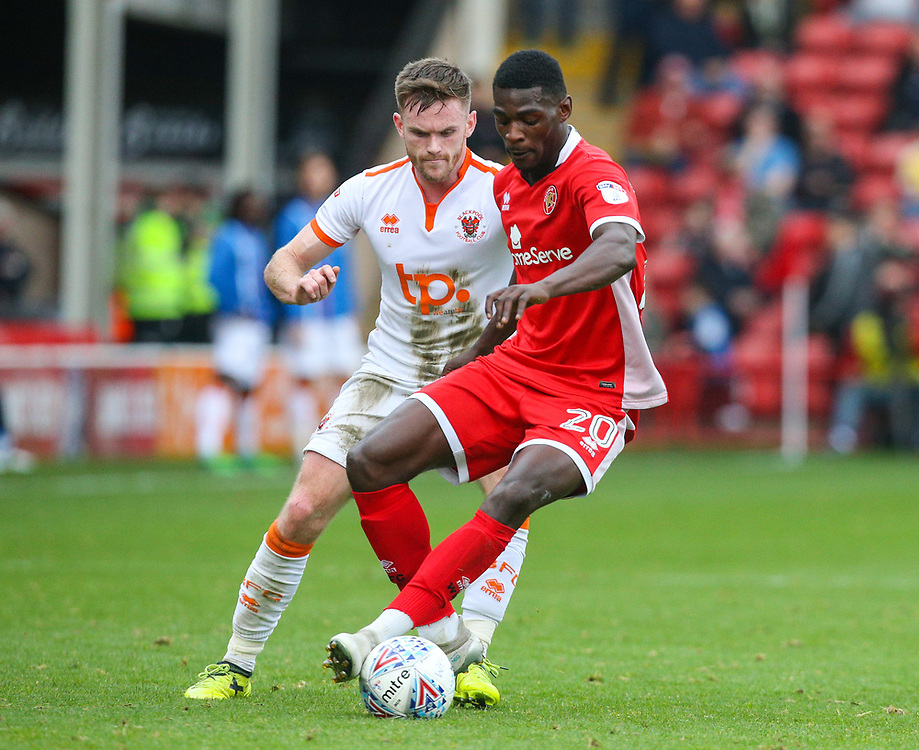 Walsall's Amadou Bakayoko holds off the challenge from Blackpool's Oliver Turton<br /> <br /> Photographer Alex Dodd/CameraSport<br /> <br /> The EFL Sky Bet League One - Walsall v Blackpool - Saturday 14th October 2017 - Bescot Stadium - Walsall<br /> <br /> World Copyright © 2017 CameraSport. All rights reserved. 43 Linden Ave. Countesthorpe. Leicester. England. LE8 5PG - Tel: +44 (0) 116 277 4147 - admin@camerasport.com - www.camerasport.com