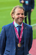 Heart of Midlothian manager Robbie Neilson is all smiles as he shows off his winners medal after the final whistle of the SPFL Championship match between Heart of Midlothian and Inverness CT at Tynecastle Park, Edinburgh Scotland on 24 April 2021.