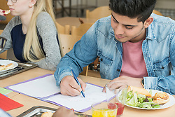University student studying in canteen and having lunch School, Bavaria, Germany