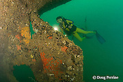 divers examine the rudder of the wreck known as the Japanese Patrol Boat, a 32 m long trawler-style WW II Japanese vessel, possibly a tugboat or submarine chaser, sunk upright in 18-25m of water in Triboa Bay, within Subic Bay, Philippines, presumed to have been sunk by an Allied air attack in 1944-1945; MR 378, 379