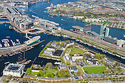 Nederland, Noord-Holland, Amsterdam, 09-04-2014;<br /> Overzicht Marineterrein en omgeving, linksbeneden het Scheepvaartmuseum, Kattenburg, de IJtunnel en museum Nemo, verder Oosterdokseiland,  Centraal Station en Piet Heinkade. Boven in beeld het IJ, Amsterdam - Noord.<br /> Navy area (bottom) and the National Maritime Museum (white building)<br /> Museum Nemo and Central Station, the IJ (water ) and its canal boats, railroad.  Top right the North of Amsterdam.<br /> luchtfoto (toeslag op standard tarieven);<br /> aerial photo (additional fee required);<br /> copyright foto/photo Siebe Swart