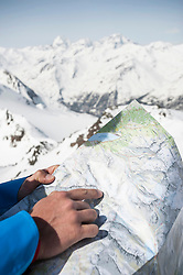 Detail close-up man reading map Alps mountains