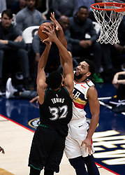 December 31, 2018 - New Orleans, LA, U.S. - NEW ORLEANS, LA - DECEMBER 31:   New Orleans Pelicans center Jahlil Okafor (8) blocks the shot of Minnesota Timberwolves center Karl-Anthony Towns (32) at New Orleans Arena in New Orleans, LA on Oct 23, 2018.  (Photo by Stephen Lew/Icon Sportswire) (Credit Image: © Stephen Lew/Icon SMI via ZUMA Press)