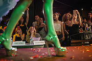 Members of the crowd look at contestants walking down the catwalk in both swimwear and evening gowns, at Istanbul's second Trans Beauty Pageant, organised by Angel of Turkey.