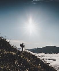 THEMENBILD - Silhouette einer Frau auf einer Bergwiese im Gegenlicht bei einer Wanderung auf den Tristkogel, aufgenommen am 16. September 2018 in Saalbach Hinterglemm, Österreich // Silhouette of a woman on a mountain meadow in the back light, Saalbach Hinterglemm, Austria on 2018/09/16. EXPA Pictures © 2018, PhotoCredit: EXPA/ Stefanie Oberhauser