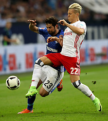 GELSENKIRCHEN, May 14, 2017  Coke (L) of FC Schalke 04 and Matthias Ostrzolek (R) of Hamburger SV vie for the ball during the Bundesliga match in Gelsenkirchen, Germany on May 13, 2017. The match ended 1-1. (Credit Image: © Joachim Bywaletz/Xinhua via ZUMA Wire)