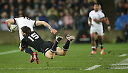 Ben Smith of the All Blacks tackles Mike Brown of England  during the third rugby test between the All Blacks and England played at Waikato Stadium in Hamilton during the Steinlager Series - All Blacks v England, Hamiton, 21 June 2014<br /> www.photosport.co.nz
