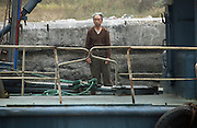 A North Korean man on a boat in the border town of Sunuiju Ocotber 10, 2006.  DPRK, north korea, china, dandong, border, liaoning, democratic, people's, rebiblic, of, korea, nuclear, test, rice, japan, arms, race, weapons, stalinist, communist, kin jong il