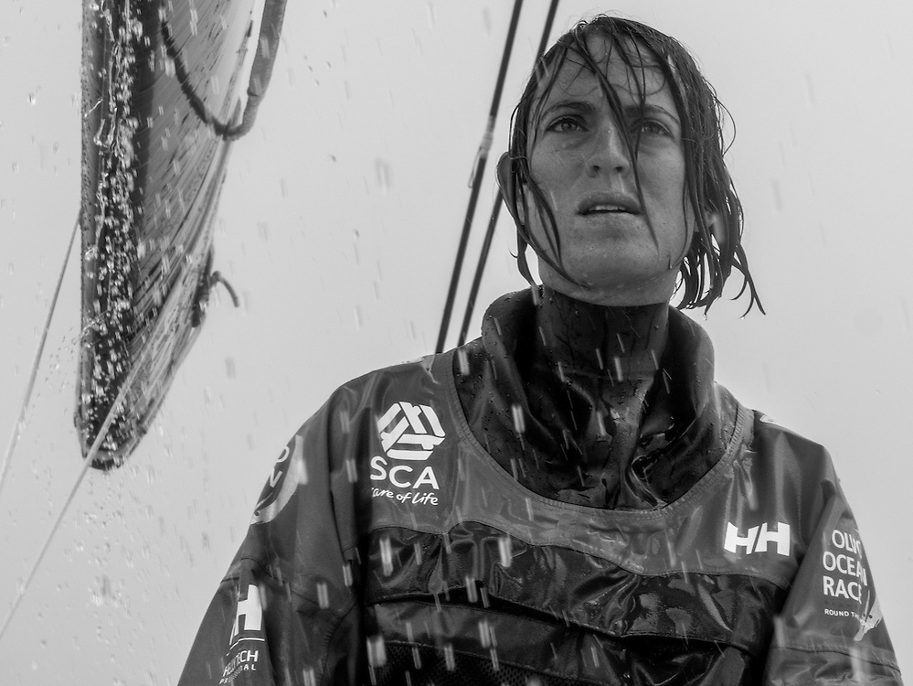 November 27, 2014. Leg 2 onboard Team SCA. Justine Mettraux trims the front sail during a rain squall.