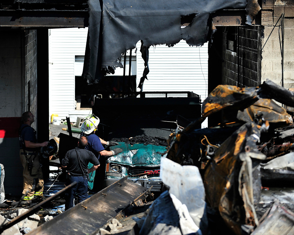 Fire investigators sift through the debris at the scene of a multiple-alarm fire that began Saturday evening at a commercial complex in the 500 block of South Benner Avenue on Sunday, July 16, 2017 in Fountain Hill. (Chris Post   lehighvalleylive.com contributor)