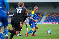 AFC Wimbledon midfielder Jaakko Oksanen (16) battles for possession during the EFL Sky Bet League 1 match between AFC Wimbledon and Lincoln City at Plough Lane, London, United Kingdom on 2 January 2021.