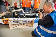 De VeloX4 wordt gefotofrafeerd tijdens de technische keuring. Het Human Power Team Delft en Amsterdam (HPT), dat bestaat uit studenten van de TU Delft en de VU Amsterdam, is in Duitsland voor een poging het uurrecord te verbreken op de Dekrabaan met de VeloX4. In september wil het HPT daarna een poging doen het wereldrecord snelfietsen te verbreken, dat nu op 133 km/h staat tijdens de World Human Powered Speed Challenge.<br /> <br /> The Human Power Team Delft and Amsterdam, consisting of students of the TU Delft and the VU Amsterdam, is in Germany for the attempt to set a new hour record on a bicycle with the special recumbent bike VeloX4. They also wants to set a new world record cycling in September at the World Human Powered Speed Challenge. The current speed record is 133 km/h.
