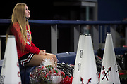 Iraan High School cheerleader Katie Kent sits on the sideline during the state championship game at AT&T Stadium in Arlington, Texas on December 15, 2016. (Cooper Neill for The New York Times)