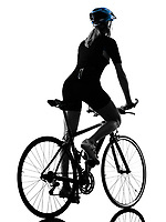 one caucasian cyclist woman cycling riding bicycle in silhouette isolated on white background rear view