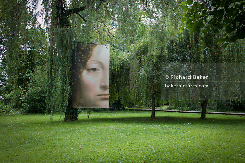 The face of 'Ginevra de Benci' in the gardens of at Chateau de Clos Lucé, home to Leonardo da Vinci for the last 3 years of his life and now a celebration of his life and achievements, Amboise, France.