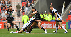Hull FC's Mark Minichiello is tackled by Leeds Rhinos' Stevie Ward during the Challenge Cup Semi Final match at The Keepmoat Stadium, Doncaster.
