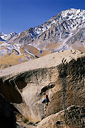 """Kevin Jorgeson making the first ascent of """"Flight of the Bumble Bee"""" a high V7 boulder problem near """"The Buttermilks,"""" in the Eastern Sierra near Bishop, California"""