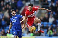 George Friend of Middlesbrough ® gets to the ball ahead of Callum Paterson of Cardiff city..EFL Skybet championship match, Cardiff city v Middlesbrough at the Cardiff city Stadium in Cardiff, South Wales on Saturday 17th February 2018.<br /> pic by Andrew Orchard, Andrew Orchard sports photography.