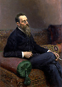 Nikolai Andreyevich Rimsky-Korsakov (1844–1908) Russian composer, a master of orchestration. Oil on canvas. Ilya Yefimovich Repin (1844–1930). Three-quarter portrait, seated on sofa half-turned  from front. Music  Musician