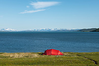 Red tent near shore of lake Virihaure along Padjelantaleden Trail, Staloluokta, Padjelanta national park, Lapland, Sweden