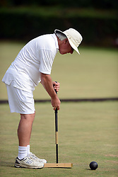 © Licensed to London News Pictures. 14/08/2013. Surbiton, UK. Brian Cumming, Canada in action. People participate in the14th World Association Croquet Championship at the Surbiton Croquet Club, Kingston upon Thames on the 14th August 2013. The Final will be played on Sunday 18th August. 80 competitors from 20 countries are taking part. Photo credit : Mike King/LNP