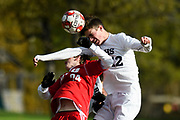 Burlington's Sean Clark (12) leaps over CVU's Chase Mitchell (24) to head the ball during the boys soccer semifinal game between The Burlington Sea Horses and the Champlain Valley Union Redhawks at CVU High School on Tuesday afternoon October 30, 2018 in Hinesburg. (BRIAN JENKINS/for the FREE PRESS)