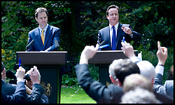 The Prime Minister David Cameron with the Deputy Prime Minister Nick Clegg at their first joint press Conference in the Rose garden of Number 10 Downing Street, Wednesday May 12, 2010. Photo By Andrew Parsons/i-Images