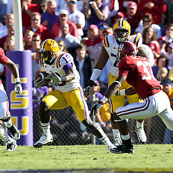 November 6, 2010; Baton Rouge, LA, USA;  LSU Tigers tight end Deangelo Peterson (19) is pursued by Alabama Crimson Tide linebacker Dont'a Hightower (30) and cornerback Robert Lester (37) during the first half at Tiger Stadium.  Mandatory Credit: Derick E. Hingle