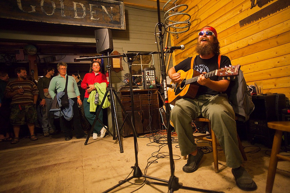 Musician Caesar Fadari, from New Orleans, performs for the crowd at the weekly Thursday open-mic night at The New Golden Saloon in McCarthy, Alaska.