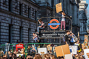 Returning to parliament square the jucnction is blocked and statues and street furniture scaled - School students go on strike over the lack of action on climate change. They gather in Parliament square and march on Downing Street, blocking the streets around westminster for over an hour.