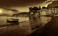 """""""The Celestial Boat of Jesus rests in Marina Grande Sorrento - BW""""…<br /> <br /> This sunset image of the lone antique fishing boat is the most iconic of the seaside views from Sorrento. The lone boat represents many perceptions and creative thoughts and portrays imagery of stillness and beauty among the restless seas. It reminds me of Saint Matthew's account of Jesus' calming of the winds and the seas: """"As Jesus got into a boat, his disciples followed him. Suddenly a violent storm came upon the sea so that the boat was being swamped by waves, but he was asleep. They came and woke him, saying, """"Lord, save us! We are perishing!"""" He said to them, """"Why are you terrified, O you of little faith?"""" Then he got up, rebuked the winds and the sea, and there was a great calm. The men were amazed and said, """"What sort of man is this, whom even the winds and the sea obey?"""" (Matt. 8:23- 27)"""