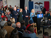 23 NOVEMBER 2019 - DES MOINES, IOWA: Former Vice President JOE BIDEN, left, listens while his wife, Dr. JILL BIDEN, right, talks about him during a campaign event in Des Moines Saturday. CHRISTIE VILSACK, and her husband, former Iowa Governor TOM VILSACK, are in the middle.  Vice President Biden announced that Tom Vilsack endorsed him. Biden and Vilsack appeared with their wives at the event in Des Moines. Iowa hosts the first presidential selection event of the 2020 election cycle. The Iowa caucuses are on February 3, 2020.            PHOTO BY JACK KURTZ