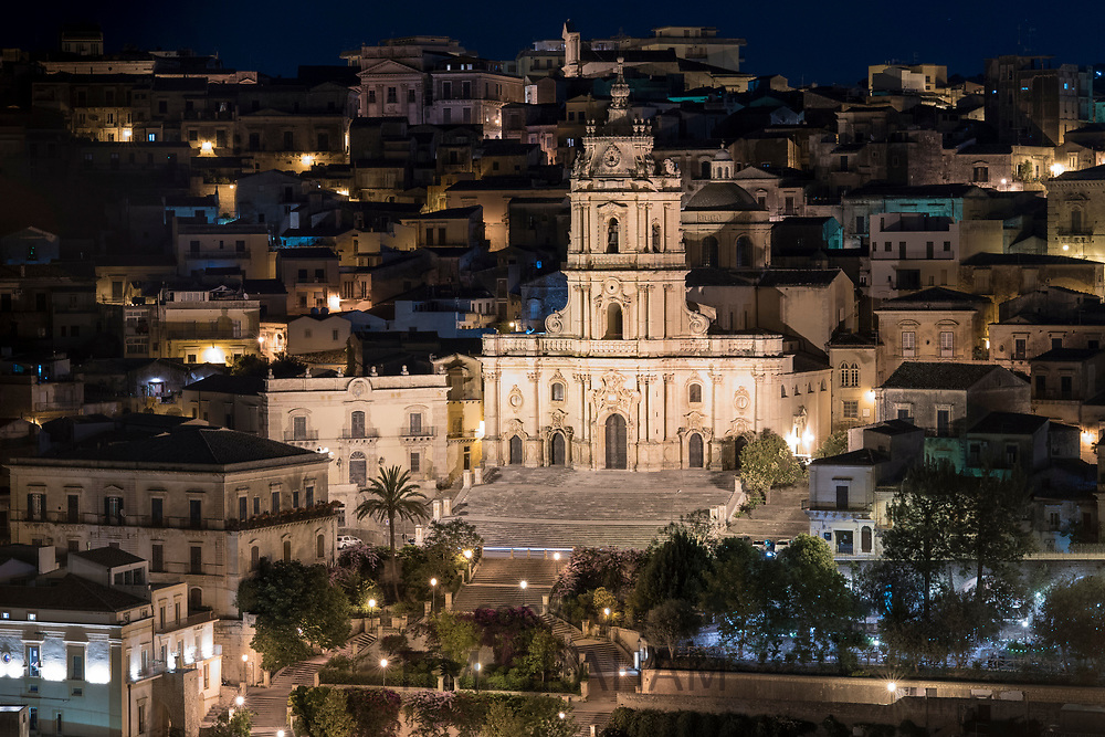 Floodlit buildings in ancient hill city of Modica Alta famous for its Baroque architecture and Cathedral of San Giorgio, Sicily