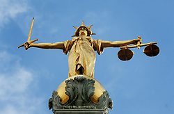 File photo dated 6/3/07 of Lady Justice, holding scales and a sword, on top of the Central Criminal Court. Labour has blamed austerity in the criminal justice system for the recent collapse of two rape cases amid concerns about the disclosure of evidence.