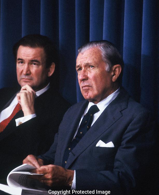Doanld Regan and Pat Buchanan listen to President Roanld Reeagan at an event in October 1985.<br /> Photo by Dennis Brack