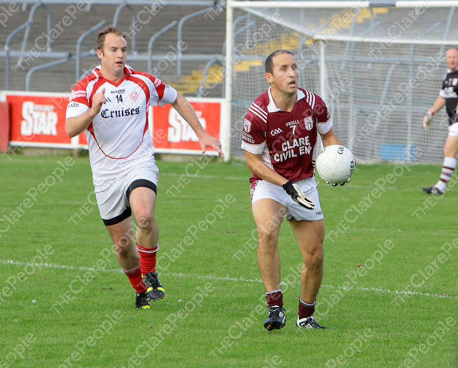 10/8/2013 Action from Cusack Park in the Jack Daly Cup SFC Round 2(Losers Group) between St Joseph's Doora Barefield and Eire Og, Ennis shows a chasing Stephen Hickey trying to catch up with Declan Malone.<br /> Picture Liam Burke/Press 22