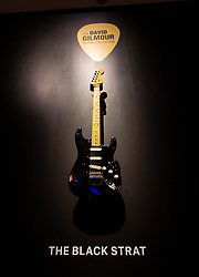 David Gilmour Guitar Collection<br /> Press view<br /> <br /> The Black Strat <br /> Fender electric instrument company <br /> A solid body. electric guitar Stratocaster <br /> Estimated $100,000 to $150,000<br /> <br /> The personal guitar collection of rock'n'roll legend David Gilmour, guitarist, singer and songwriter of Pink Floyd is unveiled at Christies, London, Great Britain <br /> 27th March 2019<br /> <br /> For the very first time, Christie's will unveil the much-anticipated preview of the personal guitar collection of rock'n'roll legend David Gilmour, guitarist, singer and songwriter of Pink Floyd, to media on Wednesday 27 March at 9.30am. The first stop for the pre-sale touring exhibition, the view will provide a once in a lifetime opportunity to see the 120+ guitar highlights being sold,<br /> with proceeds to benefit charity.<br />  <br /> The exhibition will be on view to the public from 27 to 31 March 2019. Entry will be free, with timed-tickets.<br /> <br /> Photograph by Elliott Franks