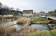 Nederland, Nijmegen, 20-2-2019Het Hollandsch Duits gemaal uit 1933 wat overtollig water uit de Ooijpolder en de Duitse Duffelt naar de rivier de waal, rijn pompt . Onder in beeld de vistrap die vissen de gelegenheid biedt ook naar de rivier te migreren .FOTO: FLIP FRANSSEN