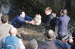 "© under license to London News Pictures. 8/3/11. Players scramble to get the ball. The Derbyshire town of Ashbourne is besieged by hoards of people as the traditional game of Shrovetide football is played out across the town. Consisting of two teams the ""Upards"" and the ""Downards""; with goal posts two miles apart. Local history has it that the game has been played since the 12th Century. Pictured: WHSmith frontage boarded up. Picture credit should read Sam Spickett/LNP"