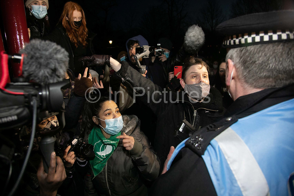Hundreds of people gathered at a peaceful vigil for Sarah Everard on Clapham Common in South London on the 13th of March 2021, London, United Kingdom. Sarah Everard went missing on 3 March after setting off at 9pm from a friend's house to make her two and a half mile journey home. People try to persuade police not to end the speeches. The vigil was also a call to end violence against girls and women perpetrated by men. The vigil was not sanctioned by police because of Covid restrictions and the police decided to arrest a number of people in an attempt to end the peaceful and highly emotional vigil. The event took place at the band stand on the common and speeches were held from the stand till police confiscated the sound equipment.