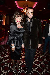 JOAN COLLINS and TOM FORD at a party to celebrate the publication of 'Passion for Life' by Joan Collins held at No41 The Westbury Hotel, Mayfair, London on21st October 2013.