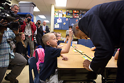 President Barack Obama allows first grader Edwin Caleb to touch his hair during a classroom visit at Clarence Tinker Elementary School at MacDill Air Force Base in Tampa, Fla., Sept. 17, 2014. (Official White House Photo by Lawrence Jackson)<br /> <br /> This official White House photograph is being made available only for publication by news organizations and/or for personal use printing by the subject(s) of the photograph. The photograph may not be manipulated in any way and may not be used in commercial or political materials, advertisements, emails, products, promotions that in any way suggests approval or endorsement of the President, the First Family, or the White House.
