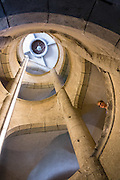 Inside the Munot's tower, ascend an impressive spiral staircase for good views, both inside and out, in Schaffhausen, Switzerland, Europe. The Munot, Schaffhausen's iconic circular fortress, was built by forced labor in 1564 after the religious wars of the Reformation.