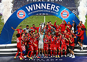 LISBON, PORTUGAL - AUGUST 23: Manuel Neuer, captain of FC Bayern Munich lifts the UEFA Champions League Trophy following his team's victory in the UEFA Champions League Final match between Paris Saint-Germain and Bayern Munich at Estadio do Sport Lisboa e Benfica on August 23, 2020 in Lisbon, Portugal.